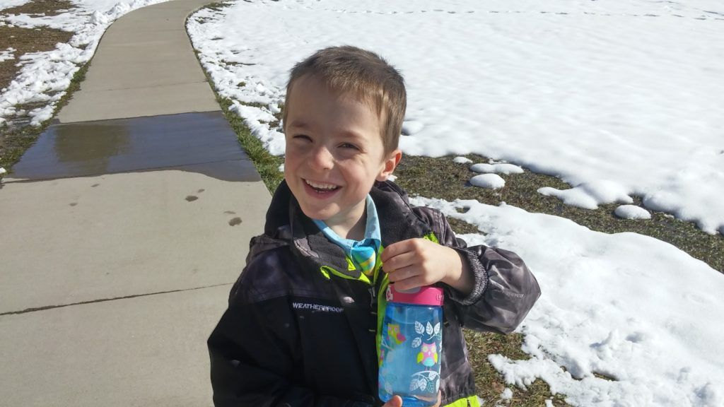 """This IS us on a walk, showing off his great idea of putting snow in a water bottle (though he later complained that it """"tasted funny"""")"""